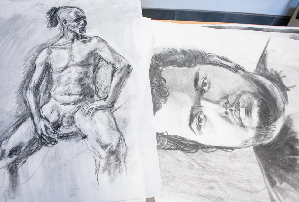 Pencil illustrations of full nude male sitting with legs open and bust of young man with beard and mustache.