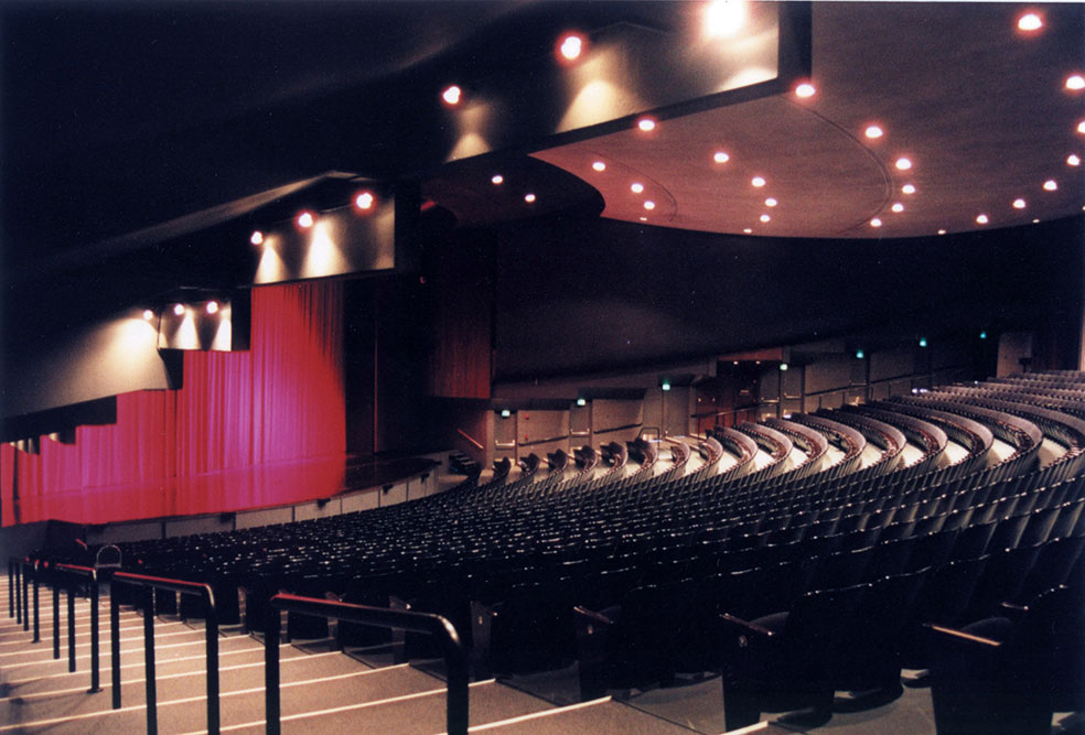 Had performance center seating viewing the stage with red curtain closed.