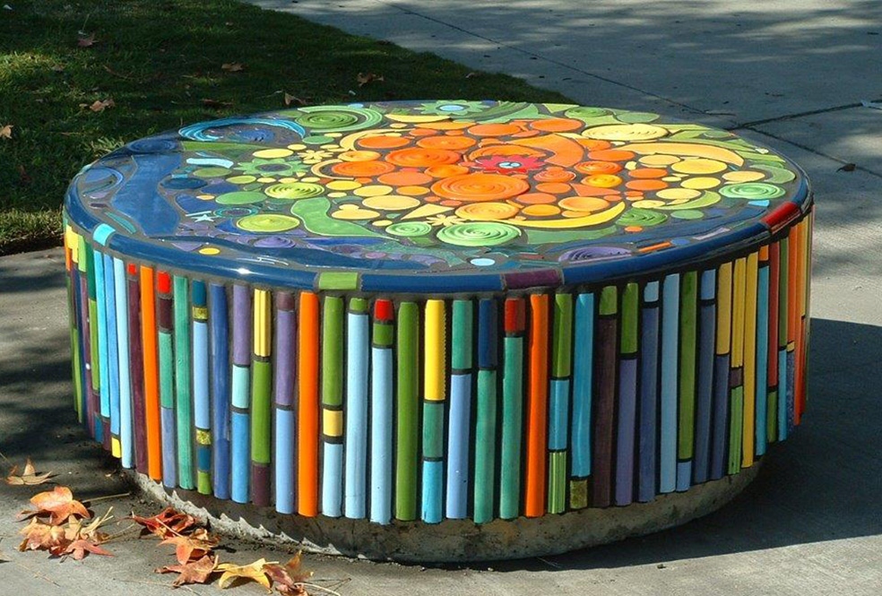 Ceramic tiled designed circular stone bench.
