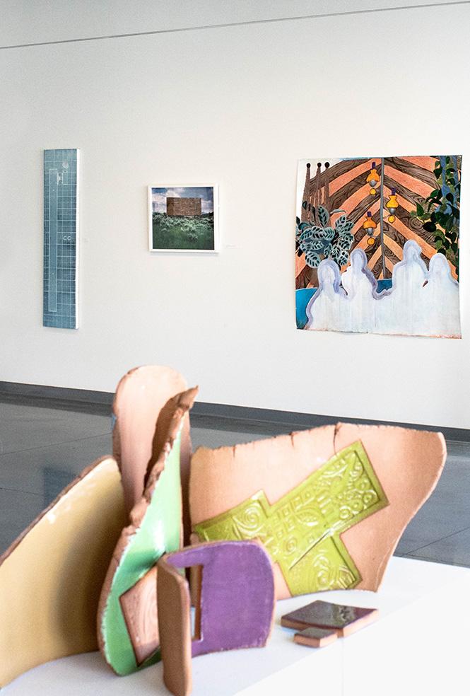 Multi piece clay display on gallery floor.