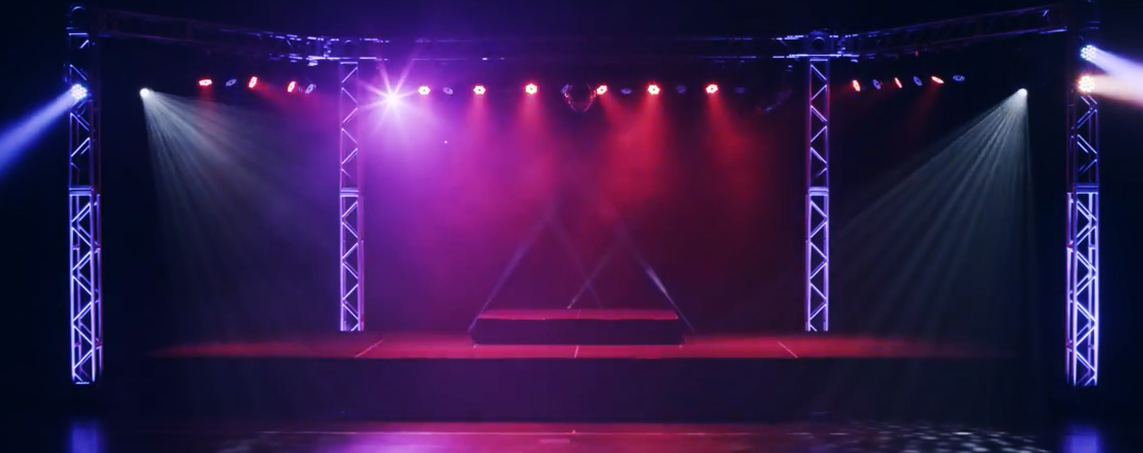 Four column trussing with par and moving head lighting on sound stage.